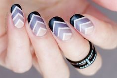 Sassy looking v-shaped Ombre nail art. Using dark colors such as black, violet and periwinkle, this nail art design gives your nails a string impression.