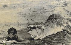 Self-portrait of photographer and adventurer Peter Beard writing his diary in 1965 from the jaws of a giant African crocodile. The 15 foot crocodile was dead - Beard had shot it earlier on the shore of Lake Rudolf in Kenya.
