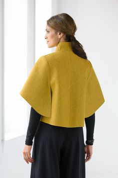 Citrino Jacket by Teresa Maria Widuch. Dynamic proportions and crisp angles make this sculptural jacket an easy-to-wear statement piece. The artist's unique arm awning sleeve design is open on bottom, providing both coverage and freedom of movement. Felted merino wool feels soft against the skin, yet is substantial enough to hold its shape for years of wear.