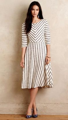Love the simple shape of the dress, especially the longer midi skirt. The stripes are adorable! #mididress