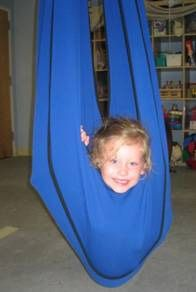 I love these swings.  We have a lycra blanket at the clinic I work in, but I want a swing!