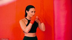 She's a fighter! Demi later showed off slicked-back locks as she donned an all-black ensemble and sported red wrap on her hands for a series of boxing-inspired shots