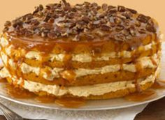 Pumpkin Cake with cream cheese filling and caramel pecan drizzle on top!!