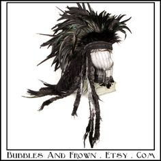 """""""Silver Seductress"""" Feather Mohawk in black with metal Gypsy veil."""