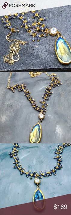 """Labradorite and Iolite  necklace Gorgeous delicate Iolite faceted stones with a flashy blue Labradorite tear drop and clear crystal pendent. Upper half of the necklace is made with a 14 karat gold fill chain and a hook to enable adjustment. The length is about 17"""" and can be less. Matana Jewelry Necklaces"""