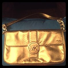 MK authentic hand bag Wore a handful .. Beautiful , gold and spacious .. NO FLAWS or stains MICHAEL Michael Kors Bags Clutches & Wristlets