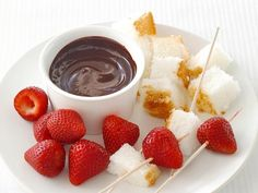 Chocolate Fondue: Have a fondue party — it's easy enough to enjoy on a weeknight. Just melt some chocolate in the microwave and let your kids skewer their favorite fruits and cubes of store-bought angel food cake.