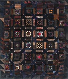 Sumptuous silk velvet Mennonite quilt in deep jewel tones offset by black, brown and grey. Circa 1880.