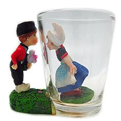 Add this unique collectible Dutch souvenir clear 3 D shot glass to your collection. This novelty clear shooter features the classic Dutch Kissing Couple making for a great gift or collectible. - Appro