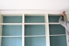 Hometalk :: Built in bookcases - ikea billy bookcases - use crown molding around for finished built-in look!