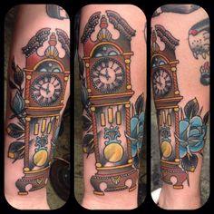 Awesome grandfather clock tattoo by Matt Lentz #tattoo #undertheneedle #seattle #clock #traditionaltattoo #roses