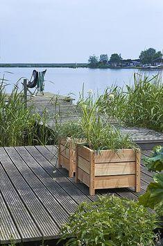 Houten bloembakken zelf maken Laag, hoog, bloeiend, groenblijvend, op elk terras horen planten.