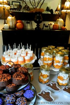 easy halloween treat ideas (jumbo candy corn marshmallows, cupcakes in a jar, cakester spiders, etc.