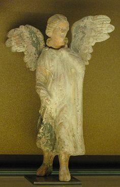 Draped Eros,a 200-250 BC,Terracotta,found in  Myrina Greek. Louvre  Museum
