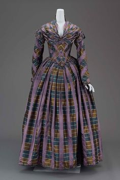 Dress MEDIUM OR TECHNIQUE Silk plaid woven and cotton-glazed lining, linen-glazed inner bodice lining, brass-colored hook and eye closures, whalebone, silk twill binding tape, and silk floss needleworked buttons American about 1840 Object Place: United States
