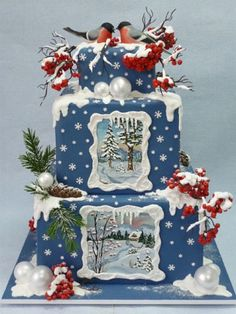 Christmas Winter Scene Cake. Blue cake, with snow and framed scenes. Lovely!