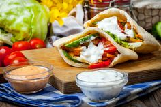 Crispy marinated chicken is topped with crunchy vegetables and wrapped in pita bread to make a delicious on-the-go meal. You can add any of your favorite vegetables and sauces to this recipe. Make Your Own Burger, Gyro Pita, Hungarian Desserts, Pita Bread, Beer Festival, Marinated Chicken, Hot Dog Buns, Chicken Recipes, Yummy Food