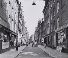 1958. A view of the Kleine Kattenburgerstraat in Amsterdam. The old houses in the street were demolished in the 1950's and 1960's. In the 1970's the street was rebuild with new residential and student housing units. Photo Serc. #amsterdam #1958 #KleineKattenburgerstraat