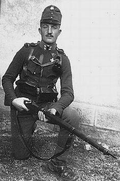 Austrian soldier holds a M95 Steyr Mannlicher rifle during World War I.