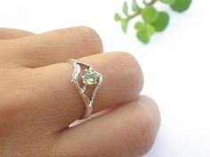 Natural Faceted Gem Stone Peridot 925 Sterling Silver Ring. $22.50, via Etsy.