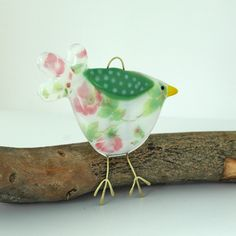 Beautiful rose patterned glass bird decoration for your home or garden. This bird has a lovely pink and green flower pattern on the body and tail feathers with a sage green spotty wing. Created from layered Bullseye glass in my Whitstable workshop. Bullseye Glass, Glass Birds, Green Flowers, Beautiful Roses, Flower Patterns, Fused Glass, Pink And Green, Create, Gifts