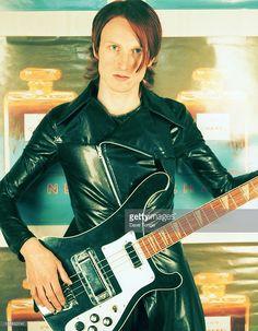 British composer and producer Micko Westmoreland, holding a Rickenbacker bass guitar, London, May 1998.