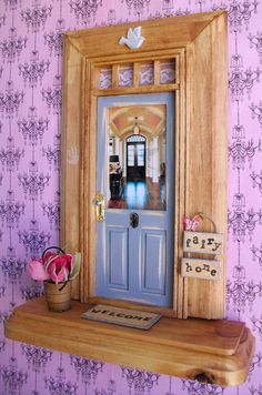 How cute it this! From Lauren English's Etsy shop... A fairy door!
