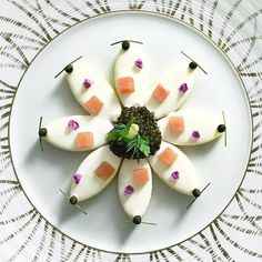 Caviar served on petals by @chef_sebastien_lepinoy of @lesamisrestaurant.  See the entire list of 5 Chefs Who Master #TheArtOfPlating in Singapore on theartofplating.com now.