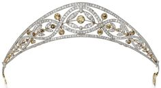 Edwardian diamond and colored diamond tiara, circa 1910. It features 6.50 carats of old European-cut, single-cut and rose-cut diamonds, accentuated by 3.25 carats of colored old European-cut and old mine colored diamonds, mounted in gold and platinum.