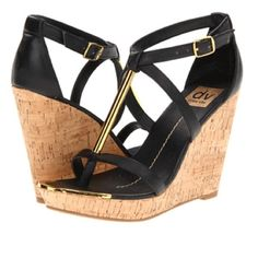 BOGO Sale!! dv by Dolce Vita Black Wedges Gorgeous summer wedges in great condition! Black with gold hardware and cork wedge. Please note small signs of wear in photos (although some of front gold accent of each wedge looks slightly lifted, it is all intact). Feel free to ask any questions or make an offer! Comes with box 😊 DV by Dolce Vita Shoes Wedges