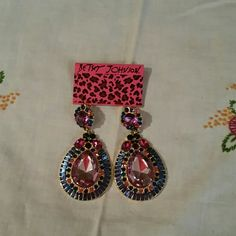 "BETSEY JOHNSON EARRINGS Colorful oversize earrings.  Predominant color is pink with teal, purple and green accents. The top that fits into the ear is 1/2"", hanging teardrop is is two inches. These are for pierced ears. Gorgeous for night out or just for fun. A girl should always have some sparkle. Priced to sell. Betsey Johnson  Jewelry Earrings"