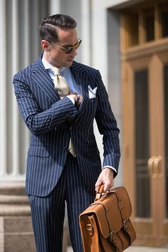 What color tie should you wear with a blue suit? And what color tie looks best with a blue suit. Here are 13 different blue suit and tie combinations. Navy Blue Striped Suit, Teaching Mens Fashion, Made To Measure Suits, Mode Costume, Pinstripe Suit, Estilo Fashion, Business Fashion, Business Suits, Business Casual