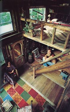 Rustic tiny cabin with loft in Boho style. Love the woodsy interior, and the wooden railings. (image only)   Tiny Homes