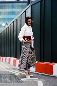 Outfit Recipe | Picnic blanket gingham skirt layered over skinny jeans. white tie front shirt and white pointed toe heels.