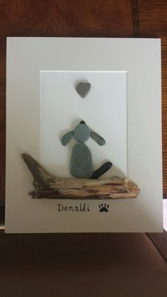 Pebble art pet memorial Pet Memorials, Pebble Art, Floating Shelves, Glass Art, Floating Bookshelves, Jar Art, Pet Memorial Stones, Stone Art
