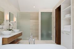 Frosted Glass Shower Corder Doors And Marble Wall Tile Also Modern Floating Vanity And Built In White Slekk Towel Cabinets Of Modern Stylish Bathroom Design: Gorgeous Modern Guest House And Spa, The 299 Soper Place