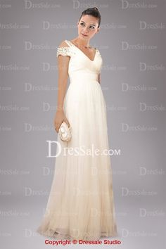Feminine Champagne Military Ball Dress Adorned by Gold Beading I also like this dress a lot.