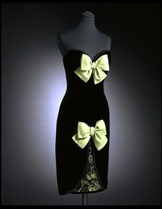 Yves Saint Laurent c. 1985 This evening dress is in black velvet edged with black satin with two pastel green grosgrain bows. It was designed by Yves Saint Laurent in Paris about Victoria and Albert Museum Collection, London 80s Fashion, Fashion History, Vintage Fashion, Vintage Ysl, Classic Fashion, Vintage Vogue, Fashion Art, Christian Dior, Yves V