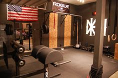 a very nice clean garage gym with awesome Abram GHD