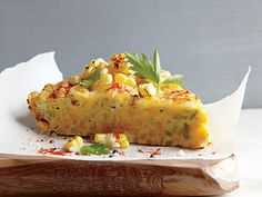 Corn Frittata with Pecorino-Romano Cheese | There isn't an herb that doesn't go well with crisp fresh corn--dill, basil, cilantro, lovage--but dark green Italian parsley is also good and bracing against the corn's sweetness. For an extra dose of smoky essence, sprinkle a pinch of smoked paprika over each serving.