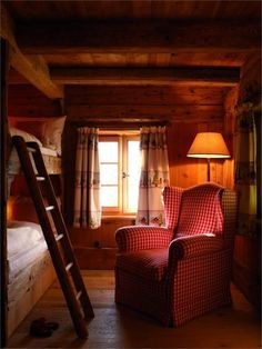 Love the red chair in the rustic bunk room