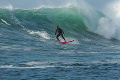 Gerard Butler surfing Mavericks during the filming of Chasing Mavericks based on the life of Santa Cruz surfer Jay Moriarity.