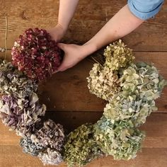 We'll show you how to cut and dry hydrangeas while they're in season, and then how to use the dried blooms to decorate an inexpensive grapevine wreath form. This handmade wreath is easy to make and as long as you're gentle while handling it and can be displayed for years to come. #hydrangeawreath #driedhydrangeas #hydrangeagarden #summerwreaths #bhg