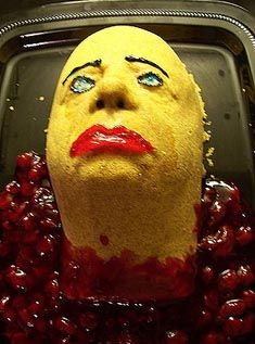 no bake cheesecake made in a face mold cherry pie filling gore is surrounding - Scary Halloween Cake Recipes