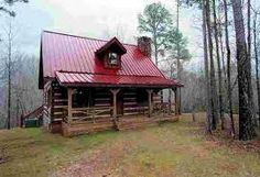 Log cabin with a red tin roof...Perfect!!!