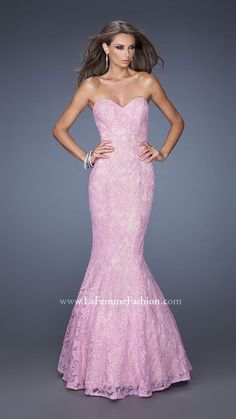 Glamorous lace mermaid gown with a nude underlay. The dress has a strapless…