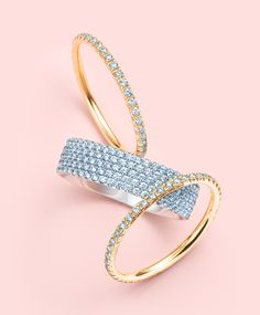 Tiffany diamonds should be applied liberally. Rings from the Tiffany Metro collection in 18k gold. Yellow gold bands flanking a five-row design in white gold.