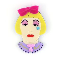Ceramics and cross-dressing. What more could you want from one of my favourite artists, Grayson Perry. I hope hed approve of this over-the-top homage to his alter-ego Claire. Theres a lot of detail going on too; with bows, pink mirror eyeshadow, purple eyebrows and a flower