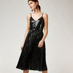 PLEATED SEQUIN CAMI DRESS £99.00  Sequins and pleats, your day just got so much better. With a v neck, spaghetti straps and a made-to-move silhouette, this midi dress was made for dancing and prancing in. Wear when your favourite song comes on.