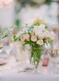 Some brides use flowers as their main form of reception décor, for others it's just an accent.